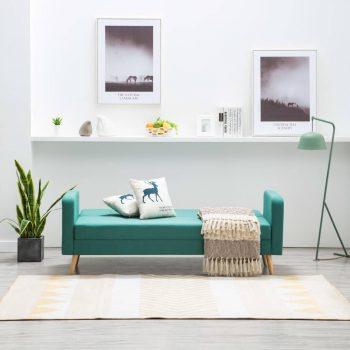 Kavč iz blaga zelene barve